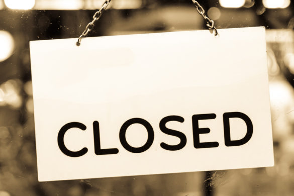 Closed sign hanging in a shop window