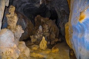 Colored stalactites and stalagmites in the cave.