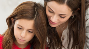 Mother Helping Her Daughter While Studying, homeschooling